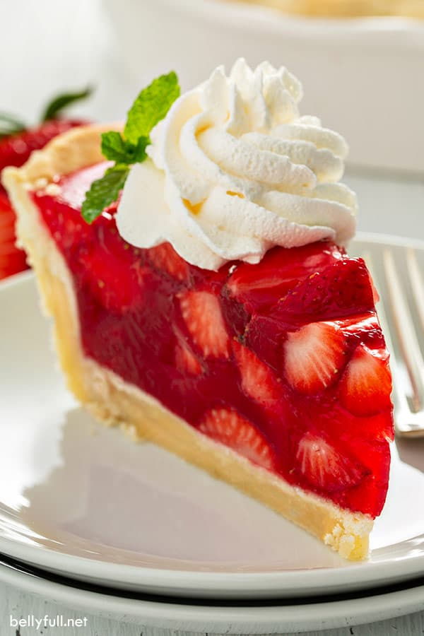 slice of strawberry pie with whipped cream