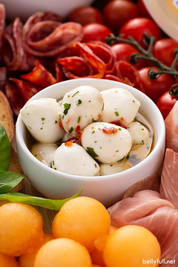 marinated mozzarella balls in small white dish