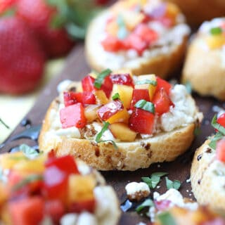fresh summer fruit bruschetta with goat cheese and basil