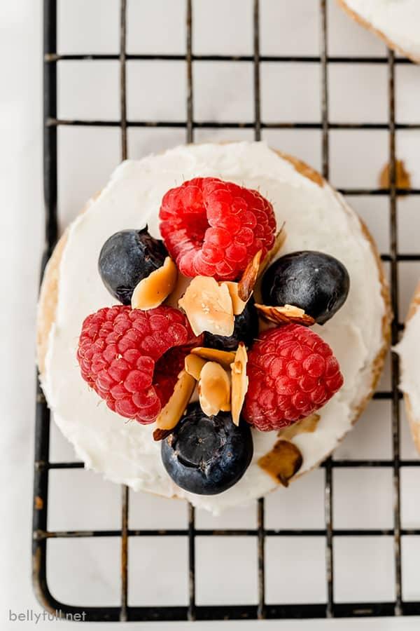 close up overhead of mini fruit tart on baking rack