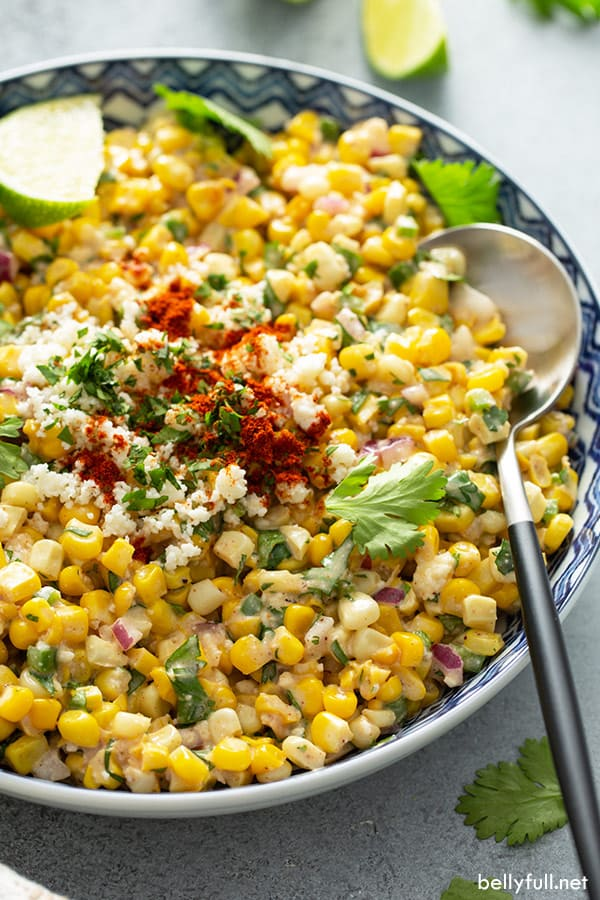 Mexican Corn Salad in ornate bowl with serving spoon