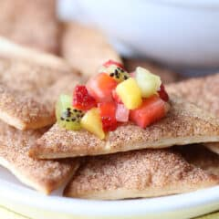 diced up fresh summer fruit sits on top of cinnamon-sugar pie crust triangles
