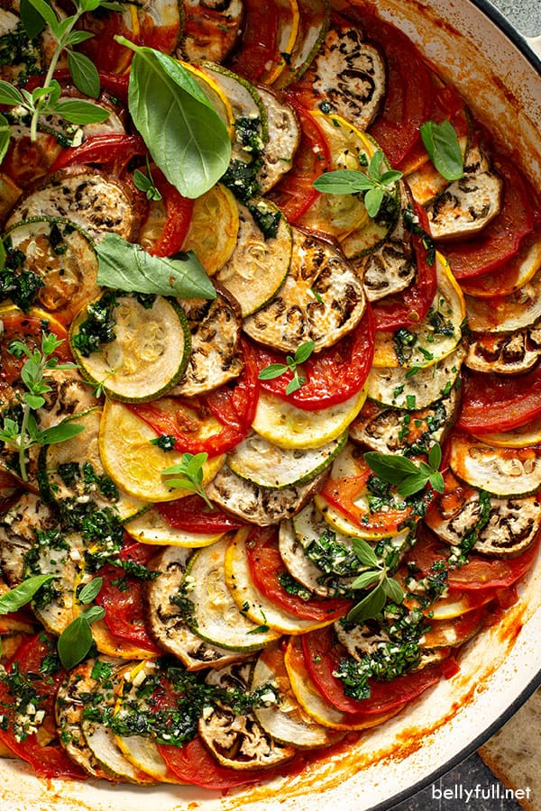 close up overhead of roasted garden vegetables in a spiral pattern