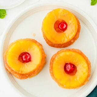 Overhead picture of 3 Individual Pineapple Upside Down Cake dessert shells on white plate