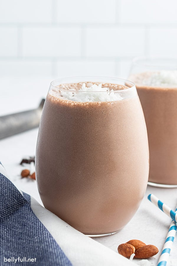 small tumbler glass filled with almond joy smoothie