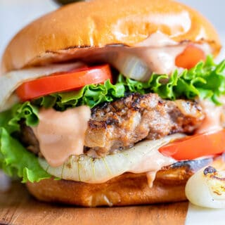 close up of grilled onion burger with all the fixins