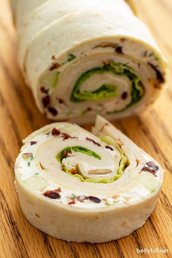 chicken salad pinwheel appetizer on cutting board