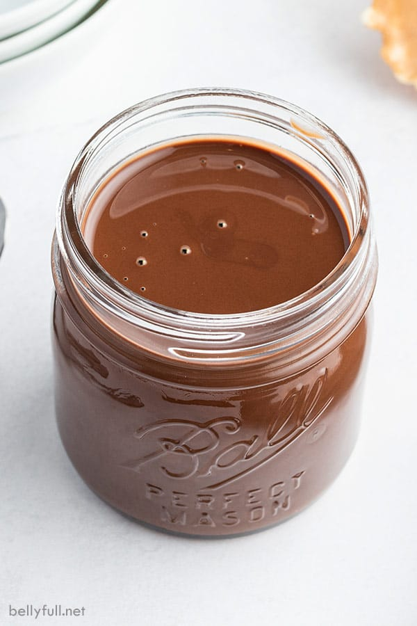 homemade Chocolate magic shell in small glass canning jar
