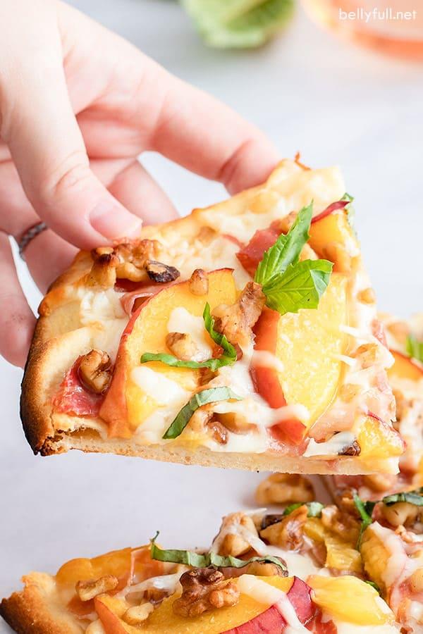 slice of flatbread pizza with coppa and peaches