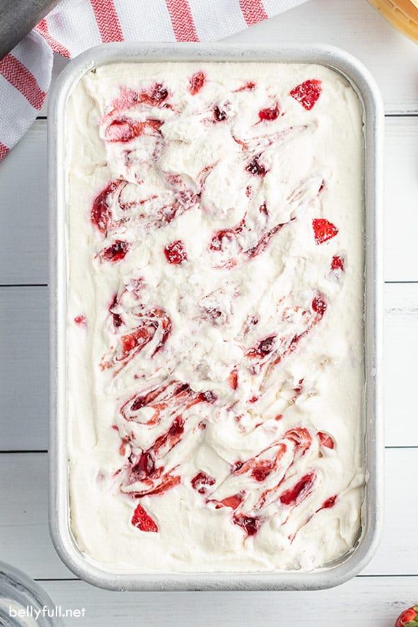overhead no churn ice cream in loaf pan with strawberry jam swirls