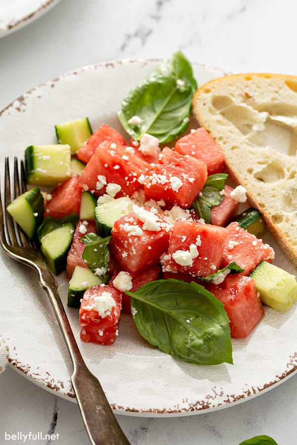 close up of watermelon feta salad on plate with fork