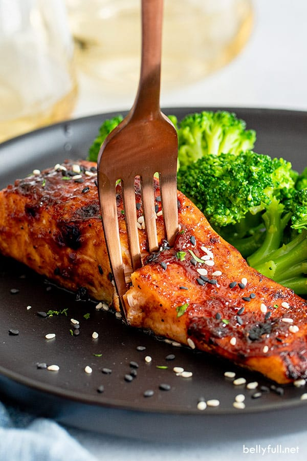 cooked hoisin glazed salmon with fork breaking into filet