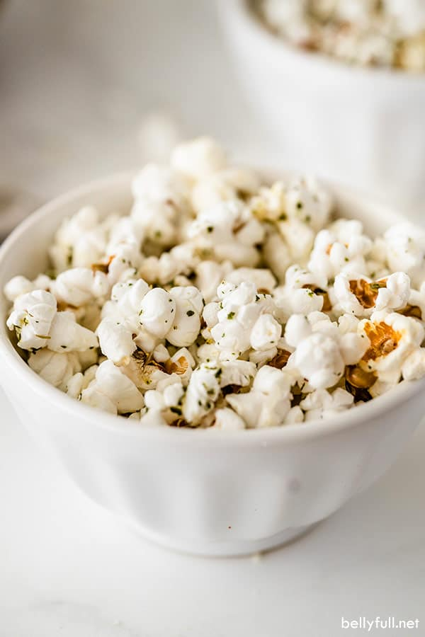 portion of garlic bread flavored popcorn in white dish