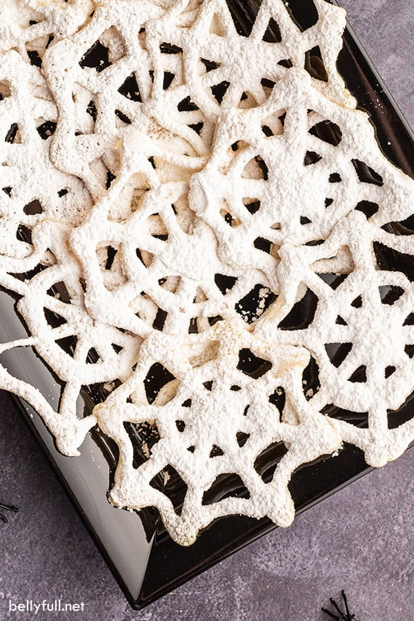 closeup overhead of black serving tray filled with spiderweb cookies