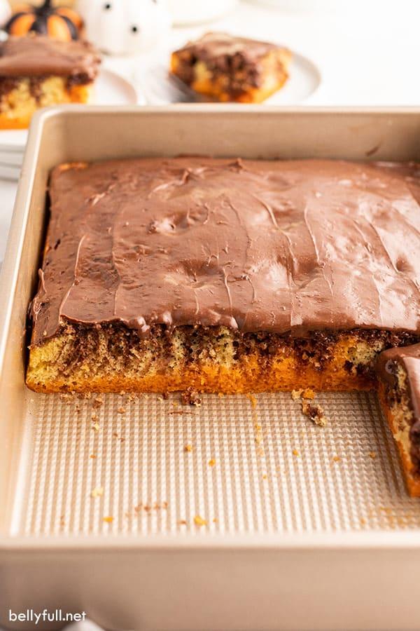 half of Halloween jello poke cake in baking pan