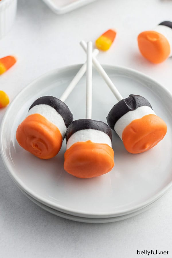 3 Halloween Marshmallow Pops laying flat on white plate