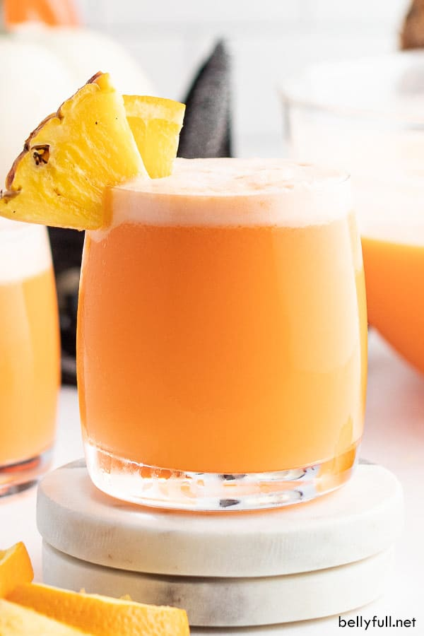 straight on picture of witches brew punch in glass with pineapple wedge