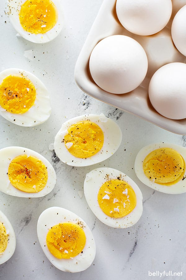 top down photo of 8 halved hard cooked eggs with salt and pepper