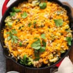 overhead skillet casserole with melted cheddar cheese