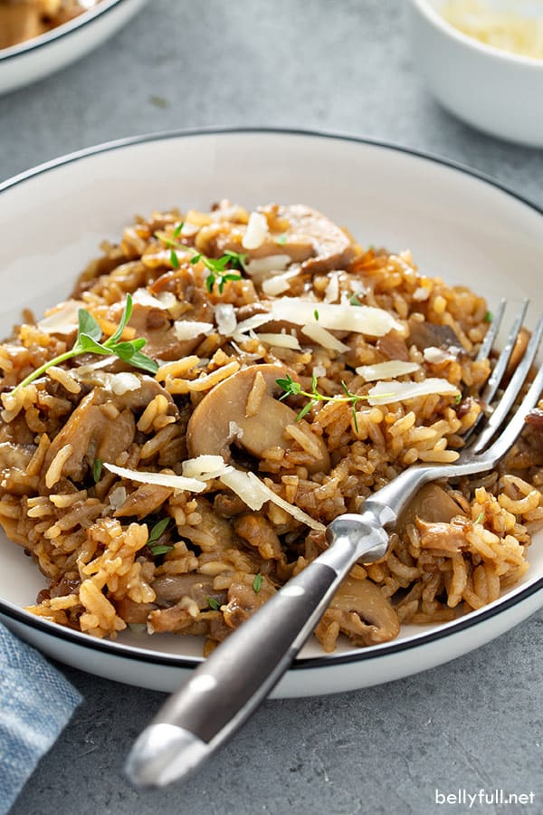 mushroom rice in white bowl with fork