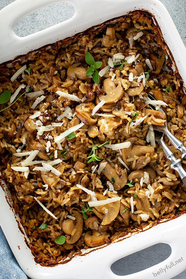 overhead of baked mushroom rice in white dish