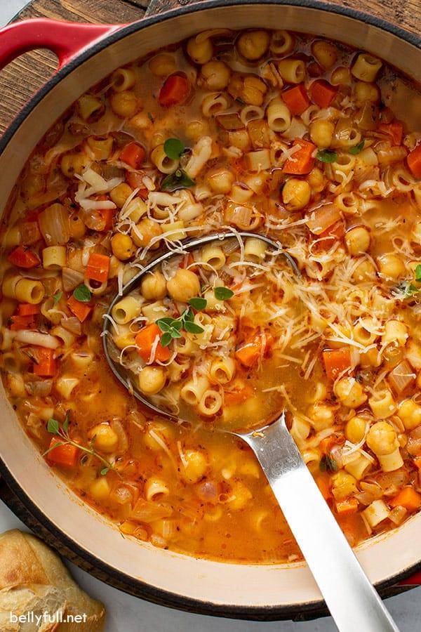 overhead of ladle in pot of pasta e ceci