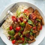 overhead pepper steak on rice in white bowl