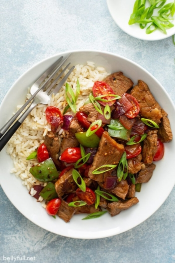 overhead pepper steak on rice in white bowl
