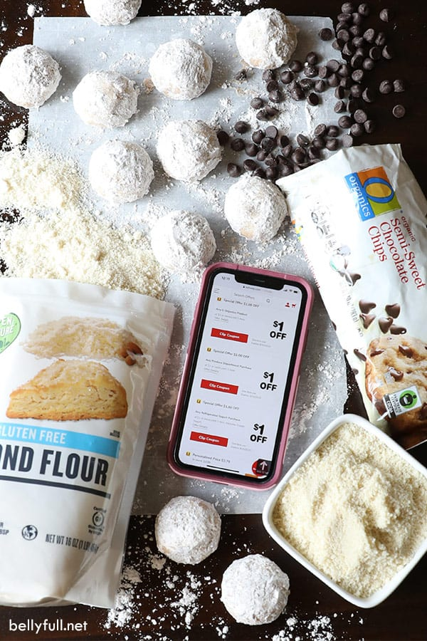 overhead of cookie ingredients with mobile phone on Safeway coupon page