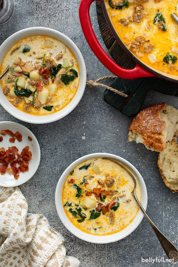 overhead of 2 white bowls filled with Zuppa Toscana soup