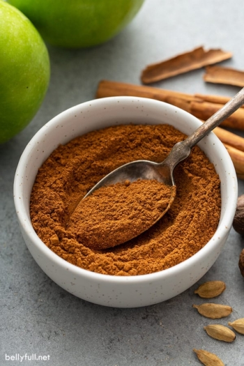 homemade apple pie spice in bowl with spoon