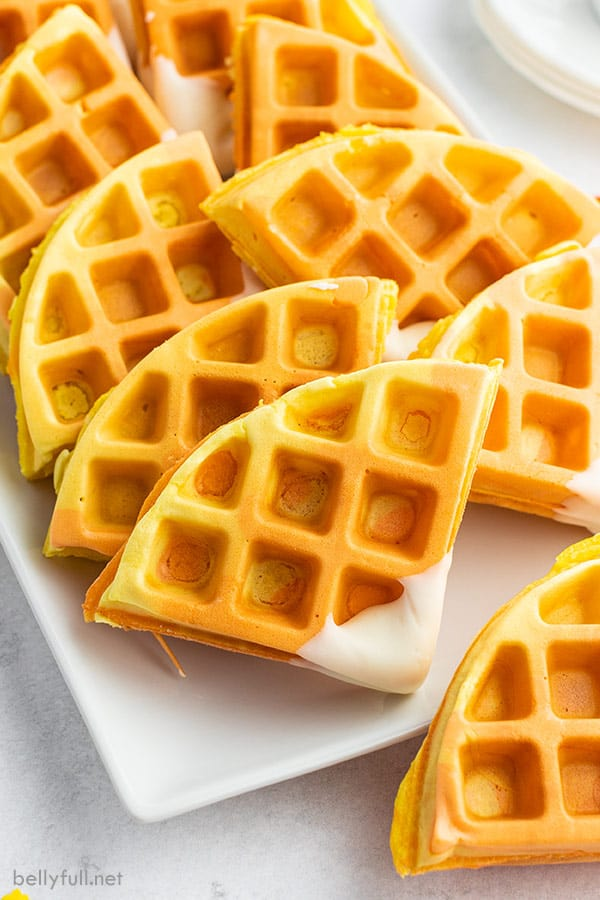 close up of candy corn colored waffles cut into triangles