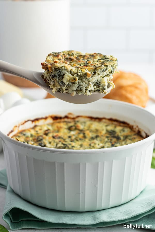 portion of spinach and feta casserole on serving spoon