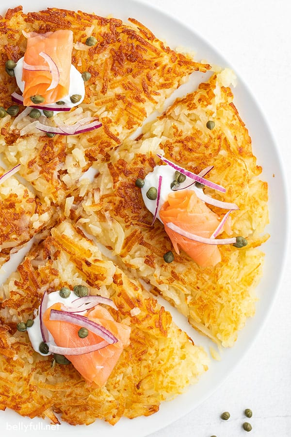 close up of hash browns on white plate, cut into sections