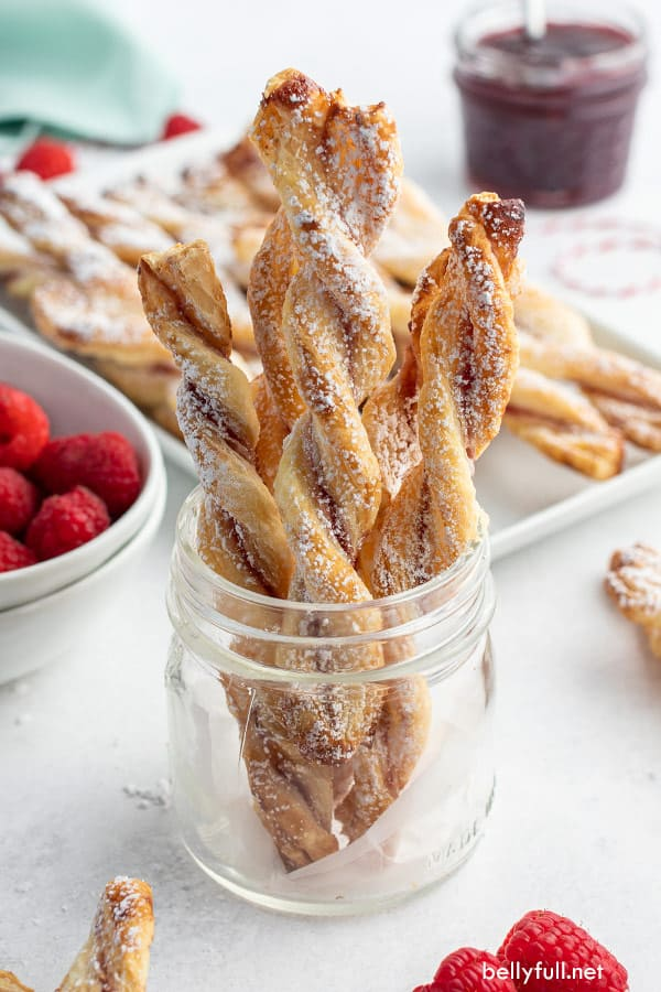 pastry jam straws standing upright in glass jar