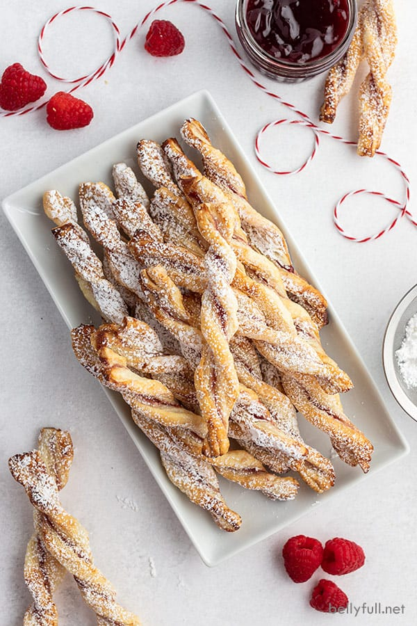 overhead of jam puff pastry twists on white serving tray