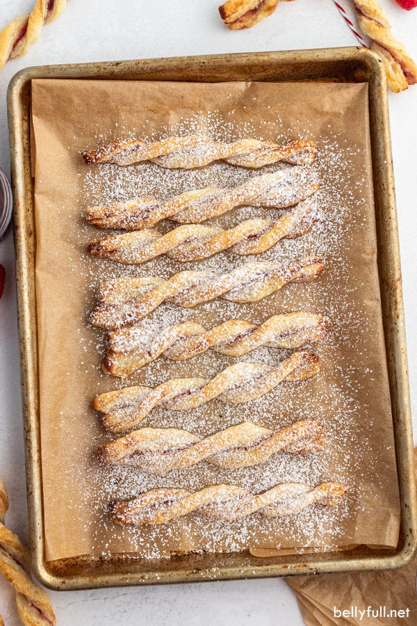 overhead of puff pastry twists on brown parchment paper