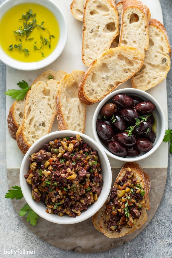 white bowl filled with pureed olives with breads slices