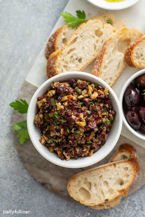 overhead of olive Tapenade in bowl with bread slices