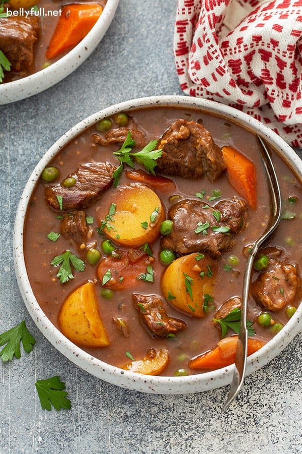 overhead of crock pot beef stew in bowl with spoon