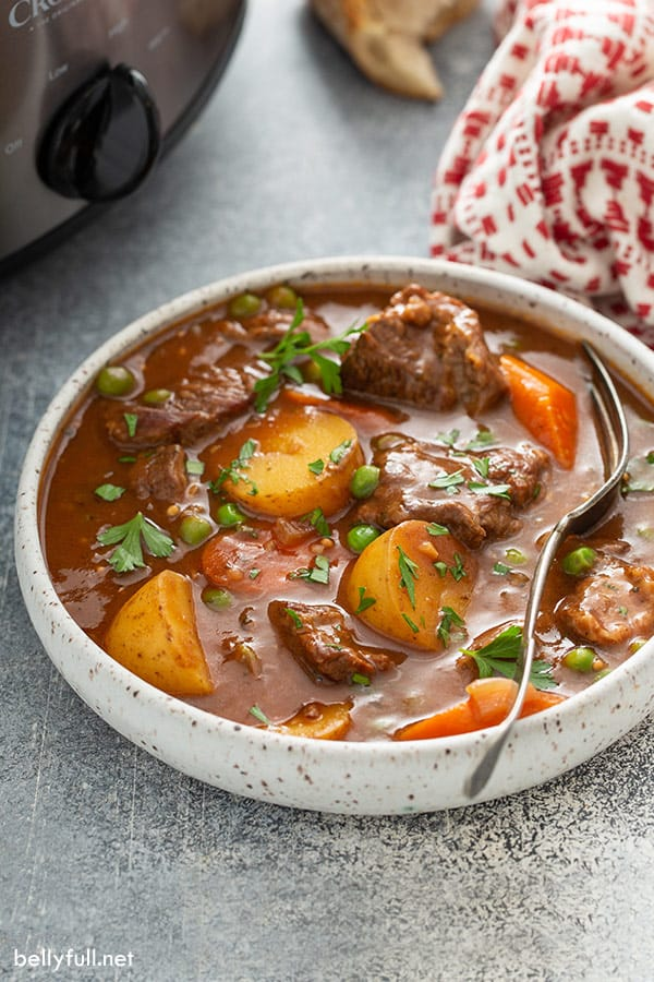 slow cooker beef stew in bowl with spoon