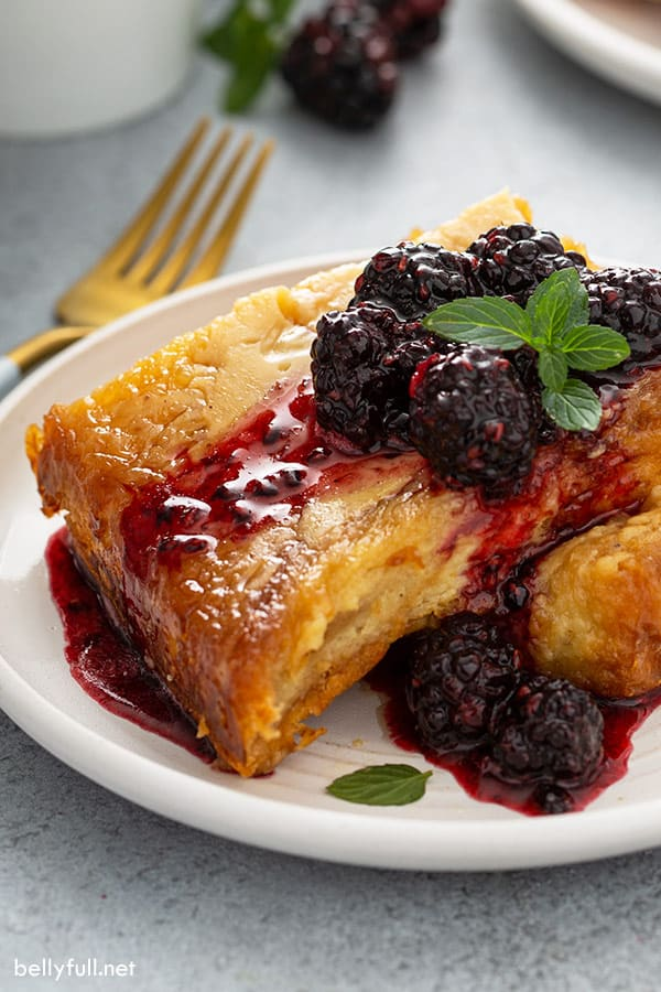 portion of Brioche French Toast on plate with fruit compote