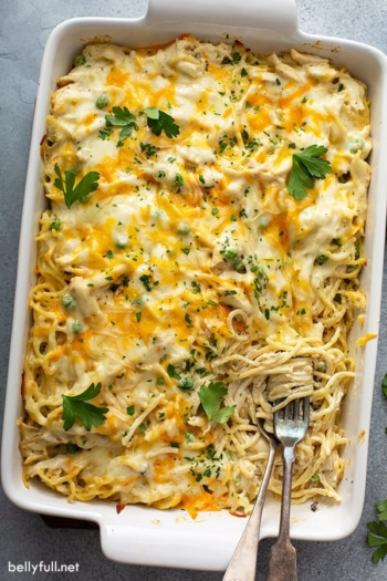 overhead of Chicken Tetrazzini in white casserole dish with fork and spoon