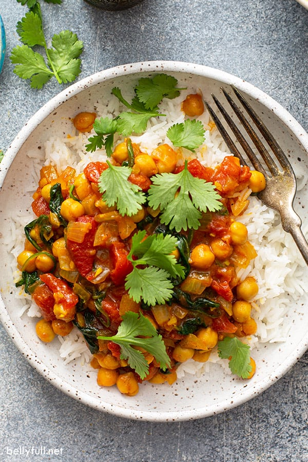 garbonzo beans in a creamy curry tomato sauce over cooked white rice