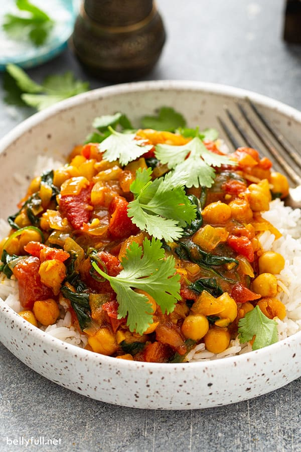 chickpeas in a creamy curry tomato sauce over cooked white rice