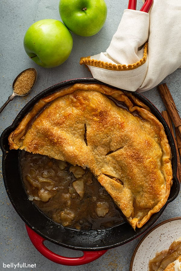 overhead skillet apple pie with half of it missing