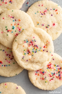 close up overhead of sprinkled baked cookies in a pile