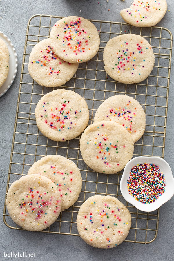 overhead of baked cookies on cooling rack with sprinkles