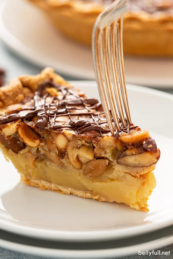 side angle of Chocolate Turtle Pie slice with fork