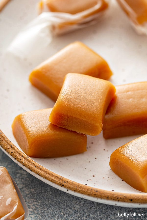 close up of caramel candy squares on plate